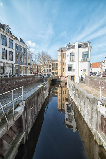 Gouda reflections Built Structure Architecture Building Exterior Water Sky Canal Cloud - Sky Nature City Building Residential District Waterfront Reflection Day Transportation Bridge No People Connection Bridge - Man Made Structure Outdoors Arch Bridge