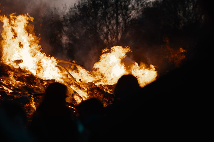 BONFIRE Bonfire Bonfire Night Bonfires Easter Fire Easter Burning Fire Fire - Natural Phenomenon Flame Heat - Temperature Nature Night Warning Sign Communication Sign Glowing Group Of People Accidents And Disasters Destruction Silhouette Dark Real People Motion Smoke - Physical Structure