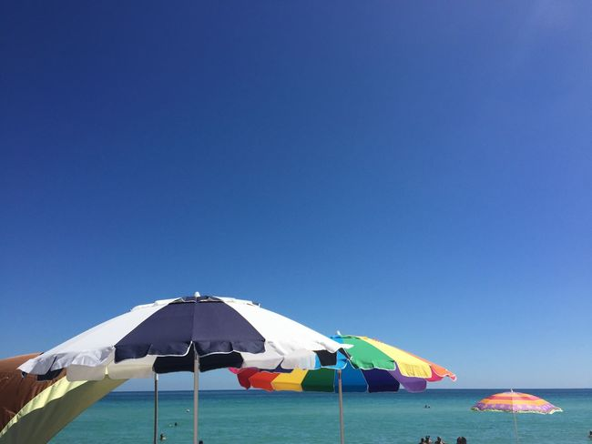 Blue Clear Sky Copy Space Day Famous Place International Landmark Multi Colored Protection Scenics Sea Sunshade Tourism Tranquil Scene Tranquility Travel Umbrella Vacations