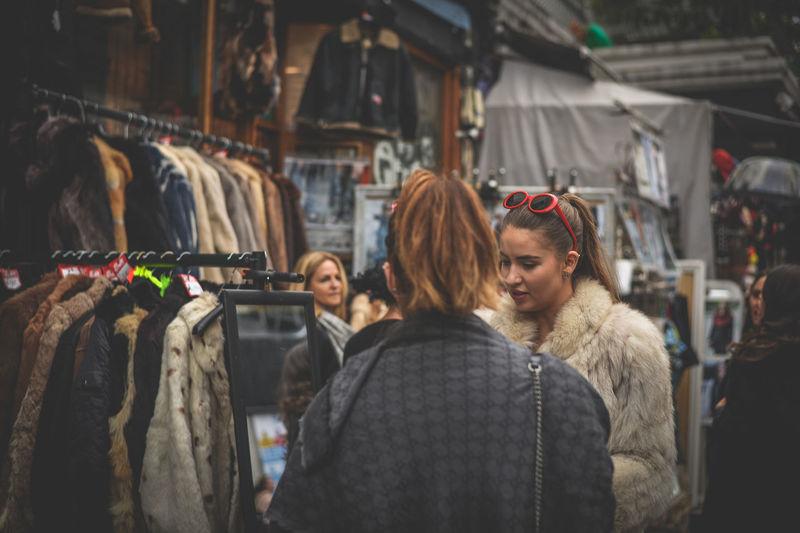Women standing in market during winter