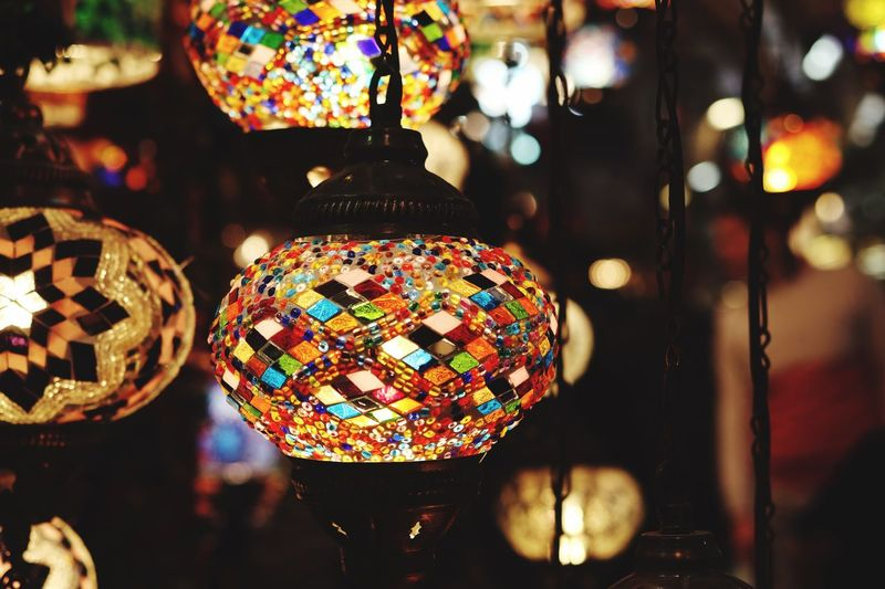 Focus On Foreground Close-up Illuminated Decoration Multi Colored No People For Sale Indoors  Pattern Night Lighting Equipment Retail  Hanging Sphere Design Selective Focus Shiny Store Glass - Material Retail Display