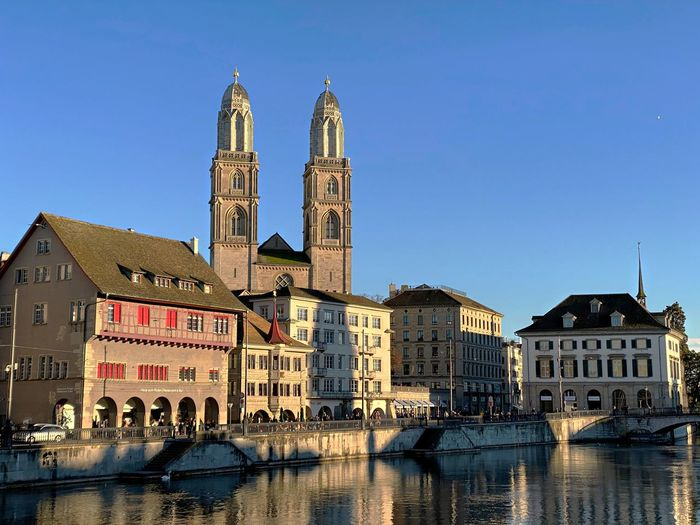 View of grossmünster in zurich against clear sky