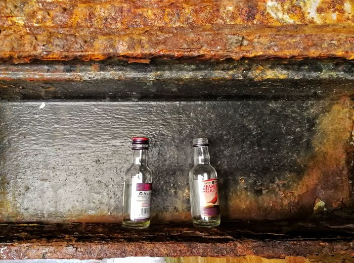 No People Outdoors Day Close-up Rusted Metal  Empty Bottles Hiding In Plain Sight Minatures Famous Grouse
