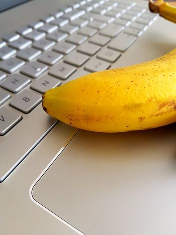 B for banana Technology Wireless Technology Yellow Laptop Computer Keyboard Computer Communication Food And Drink Business Finance And Industry Internet Close-up Indoors  Computer Part Letter B Healthy Eating Business Studio Shot Computer Key Alphabet Initial