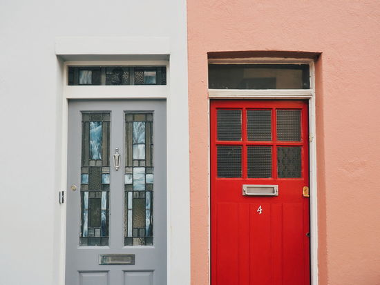Architecture Backgrounds Building Building Exterior Built Structure Close-up Closed Color Day Door Doors Exterior Façade Full Frame Neighborhood No People Outdoors Pastel Colors Red Repetition Residential Building Residential Structure Side By Side Window