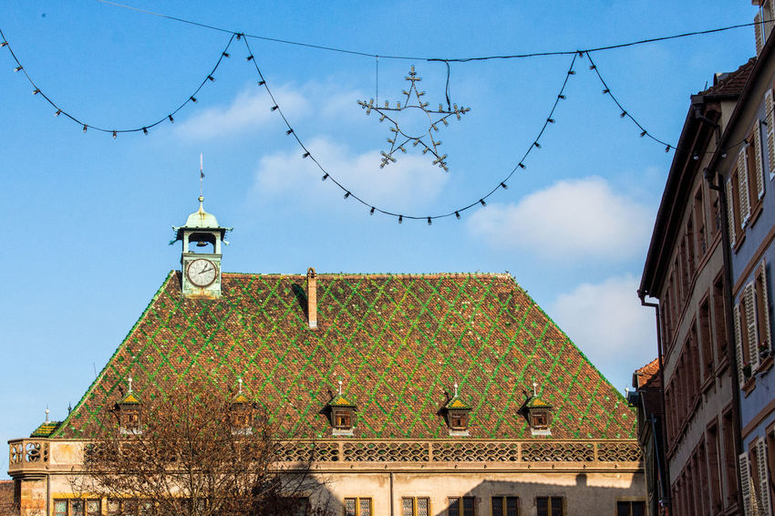 Shot of a typical Colmar tiled roof on a sunny day with a christmas star decoration Architecture Blue Building Exterior Built Structure Colmar Colmar Architecture Colmar, Alsace, France Day Low Angle View No People Outdoors Roof Rooftop Sky Sunny Tiled Roof  Tiles