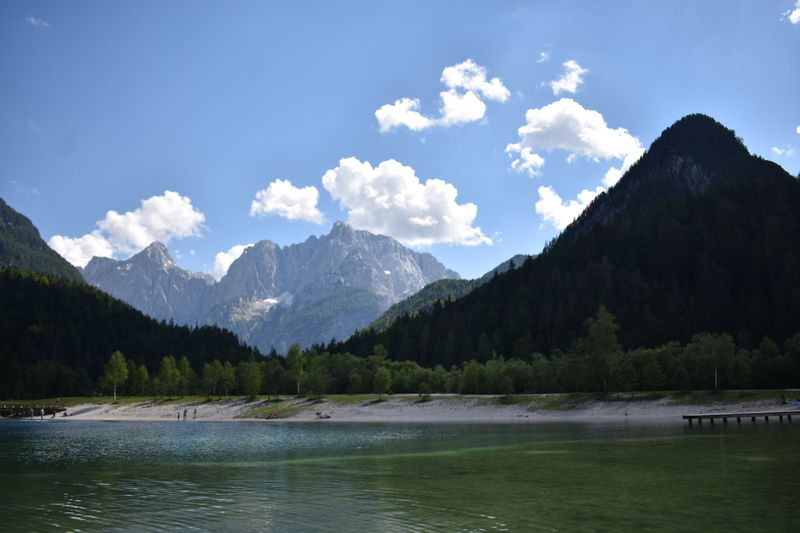 Lakes & Mountains in Lake Jasna, Slovenia Mojstrana Beauty In Nature Cloud - Sky Day Environment Idyllic Lake Lake Jasna Mountain Mountain Peak Mountain Range Nature No People Non-urban Scene Outdoors Plant Range Scenery Scenics - Nature Sky Tranquil Scene Tranquility Tree Water Waterfront
