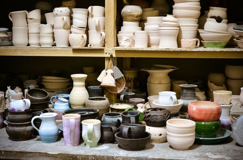 Various ceramics displayed for sale at market stall