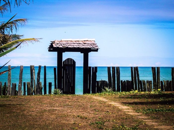 Doorsworldwide Gates To Paradise Sky Blue Architecture Built Structure Nature No People Outdoors Day Beauty In Nature Water Building Exterior Scenics Beach Horizon Over Water Fence Art Blue Green Sea Travel Caraíva - Brazil Doorway Wood Fence EyeEmNewHere