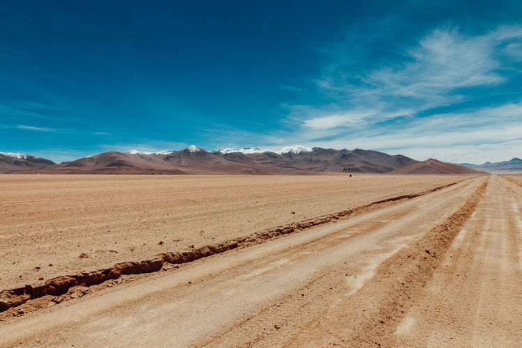Altiplano Andes Arid Climate Beauty In Nature Blue Bolivia Brown Cloud - Sky Day Desert Landscape Mountain Mountain Range Nature Nature No People Outdoors Road Sand Sand Dune Scenics Sky Tire Track