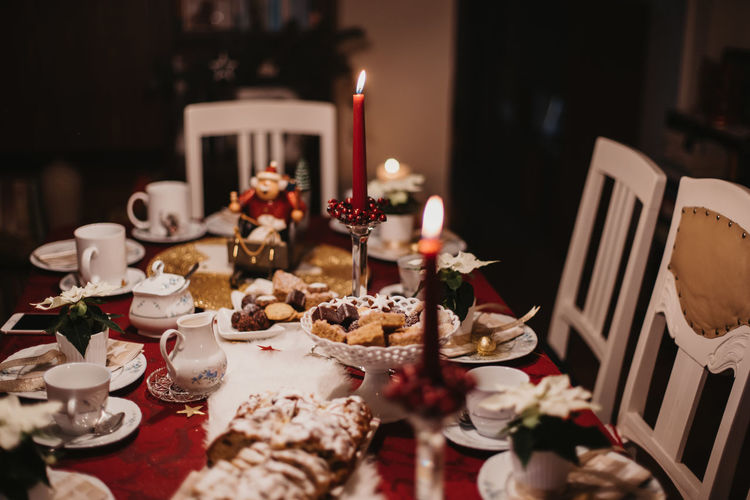 cookies and stollen on a festive table ready laid on Christmas eve Food And Drink Table Food Candle Indoors  Plate Celebration Selective Focus Freshness Sweet Food Still Life No People Sweet Ready-to-eat Holiday Dessert Illuminated Baked Glass Setting Meal Temptation Dinner Candle Festive