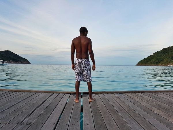 Clear Water Shirtless Man Beach Tropical Island Pier Island Black Male Bare Back Redang Island Vacations On The Pier Shirtless Malaysia Water Tropical Swimming Trunks Man In Bathing Suit One Man Only Man On Pier Black Man In Shorts Horizon Over Water Slender Man Athletic Bare Back