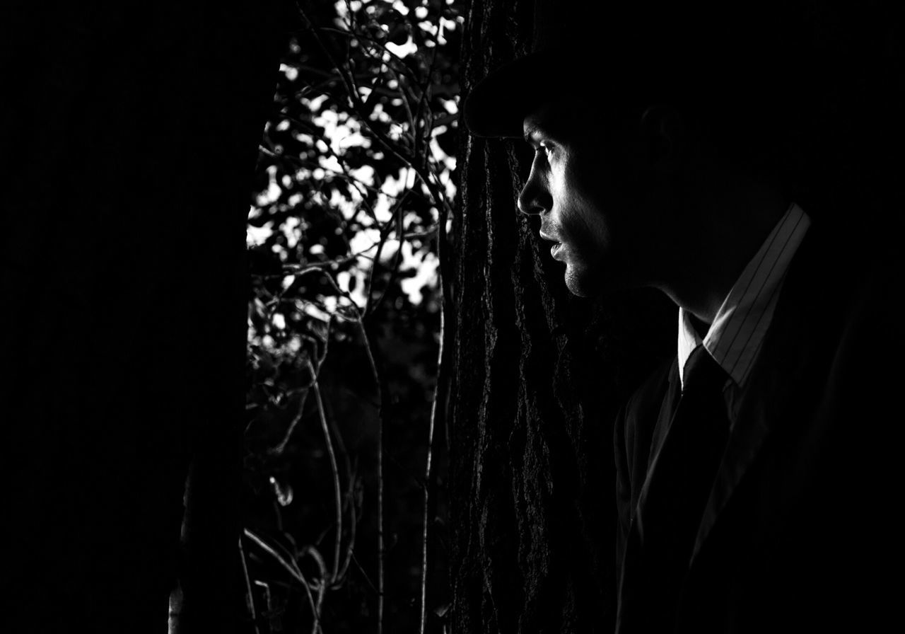 Young Man Looking Towards Trees