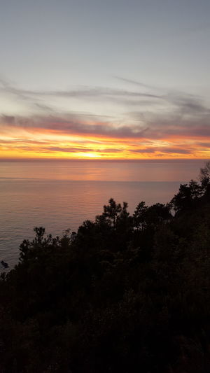 Sunset Horizon Over Water Sea Reflection Sky Dramatic Sky Beauty In Nature TranquilityOutdoors Sunlight Liguria,Italy Silhouette Beauty Nature Beach Cloud - Sky Scenics Landscape Water No People Red