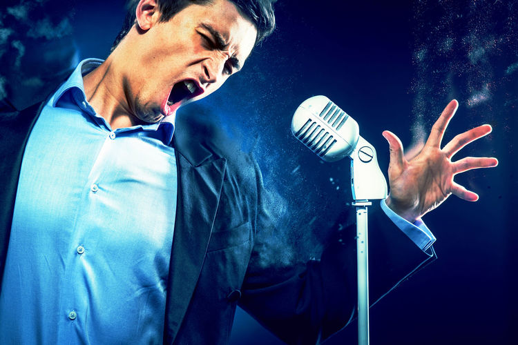 Young handsome man singing. Image with a digital effects Altered Artist ArtWork Brunette Classic Digital Art Digitally Generated Elegant Emotional Expression Expressive Graphic Jacket Macho Man Microphone Music Musician Opera Singer People Performance Singer  Singing Suit Vocal