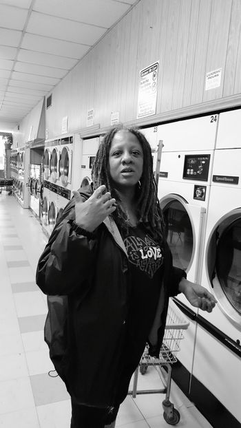 Washing Machine Indoors  Laundry Looking At Camera Laundromat Waiting One Person Washing Portrait Adults Only One Woman Only Cleaning People Chores Adult Only Women One Young Woman Only Day First Eyeem Photo