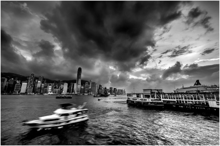 Heartbeat of the City The Great Outdoors - 2019 EyeEm Awards Cloud - Sky Transportation Building Exterior Waterfront Outdoors Skyscraper Cruise Ship Cityscape Harbour Slow Shutter Blackandwhite Black And White Mode Of Transportation Ferry Cloudy