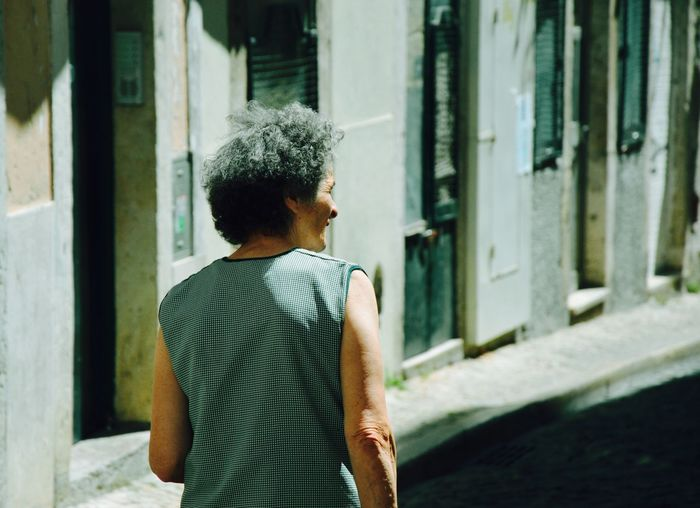 Woman on street Contemplation Green Landscape Looking Through Window One Person People Portrait Portugal Rear View View Visit Window Woman Women