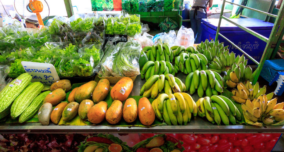 Fruits and vegetables for sale at market stall