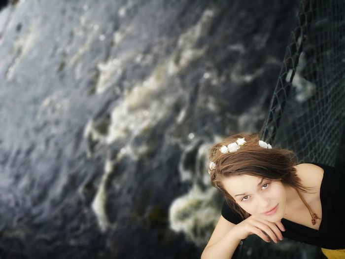 High Angle Portrait Of Teenage Girl Standing Against River