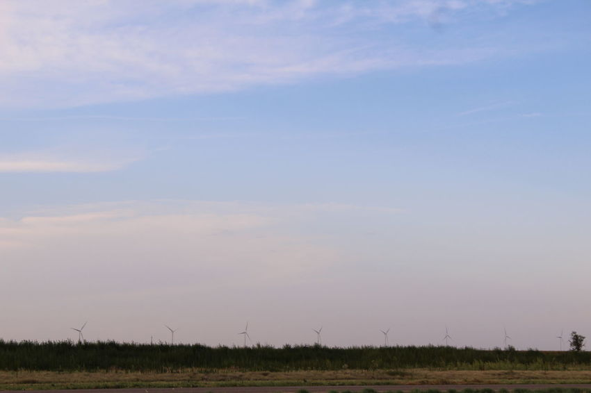 Beauty In Nature Blue Sky Clouds And Sky Day Field Grass Grass Green Green Green!  Horizon Over Land Landscape Landscape_photography Landscapes Nature No People Open Space Outdoors Sky Tranquil Scene Tranquility Wind Turbine In A Row Sustainable Energy