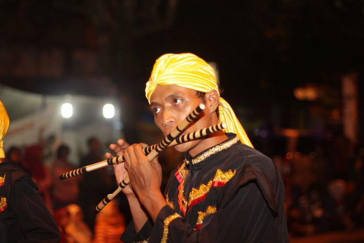 Man playing flute at night