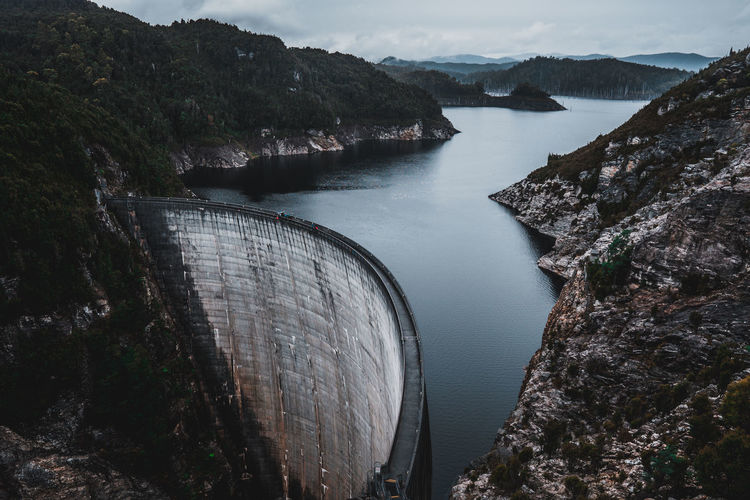 Architecture Beauty In Nature Built Structure Dam Day Environmental Conservation Flowing Water Fuel And Power Generation High Angle View Hydroelectric Power Mountain Nature No People Outdoors Renewable Energy Reservoir River Scenics - Nature Sky Water
