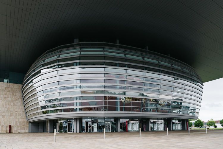 Exterior view of the Modern Opera House in Copenhagen a cloudy day of summer Architecture Architecture Building Building Exterior Built Structure City Cityscape Culture Day Design Europe Futuristic Iconic Iconic Buildings Iconic Landmark Landmark Modern Nordic Nordic Countries Opera House Scandinavia Theater Tourist Attraction  Travel Travel Destinations