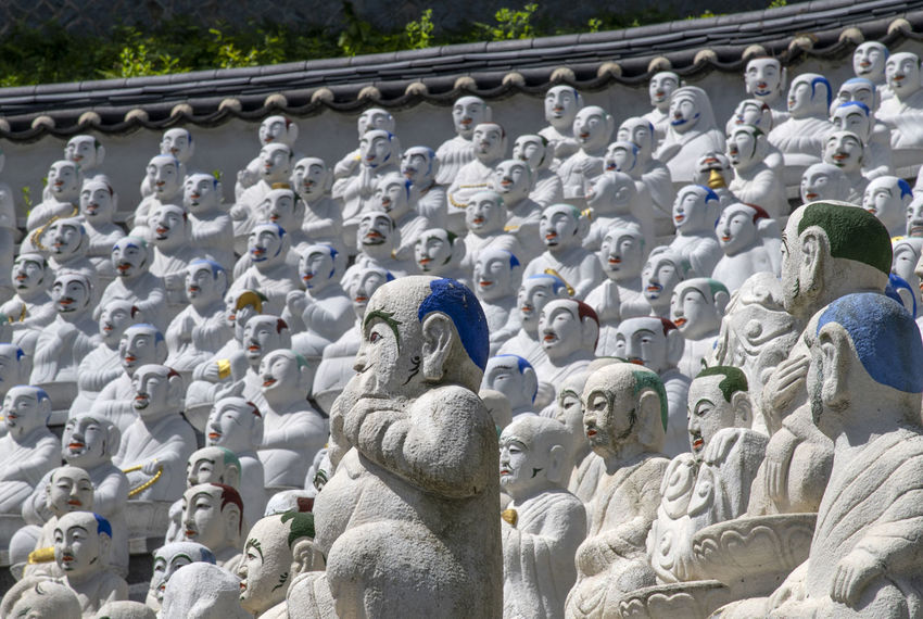 view of Bomunsa, a famous Buddhism temple at Seokmodo in Ganghwado, Kimpo, Gyeeonggido, South Korea Bomunsa Buddhism Temple Seokmodo Architecture Art And Craft Belief Buddhism Craft Creativity Day Female Likeness Ganghwado Gray Human Representation In A Row Male Likeness No People Outdoors Religion Religious  Representation Sculpture Spirituality Statue Stone Material Temple