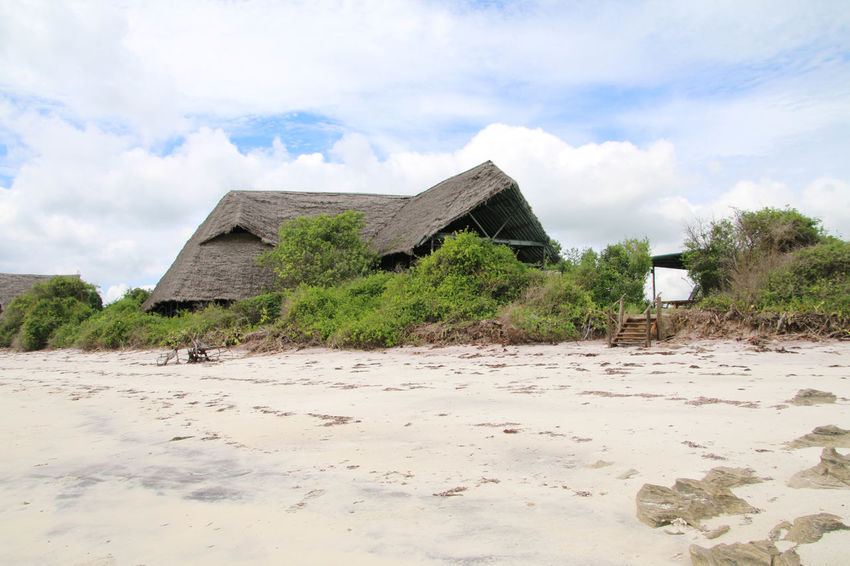 Ecological holiday resort Architecture Beach Beach Hut Beauty In Nature Building Exterior Built Structure Cloud - Sky Day Eco Tourism House Landscape Nature No People Outdoors Sand Scenics Sky Thatched Roof Tranquil Scene Tranquility
