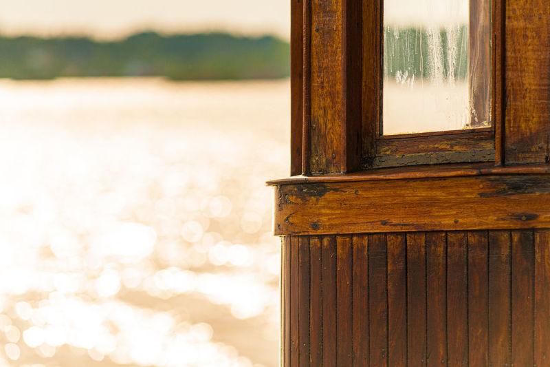 Close-up of window on wooden door