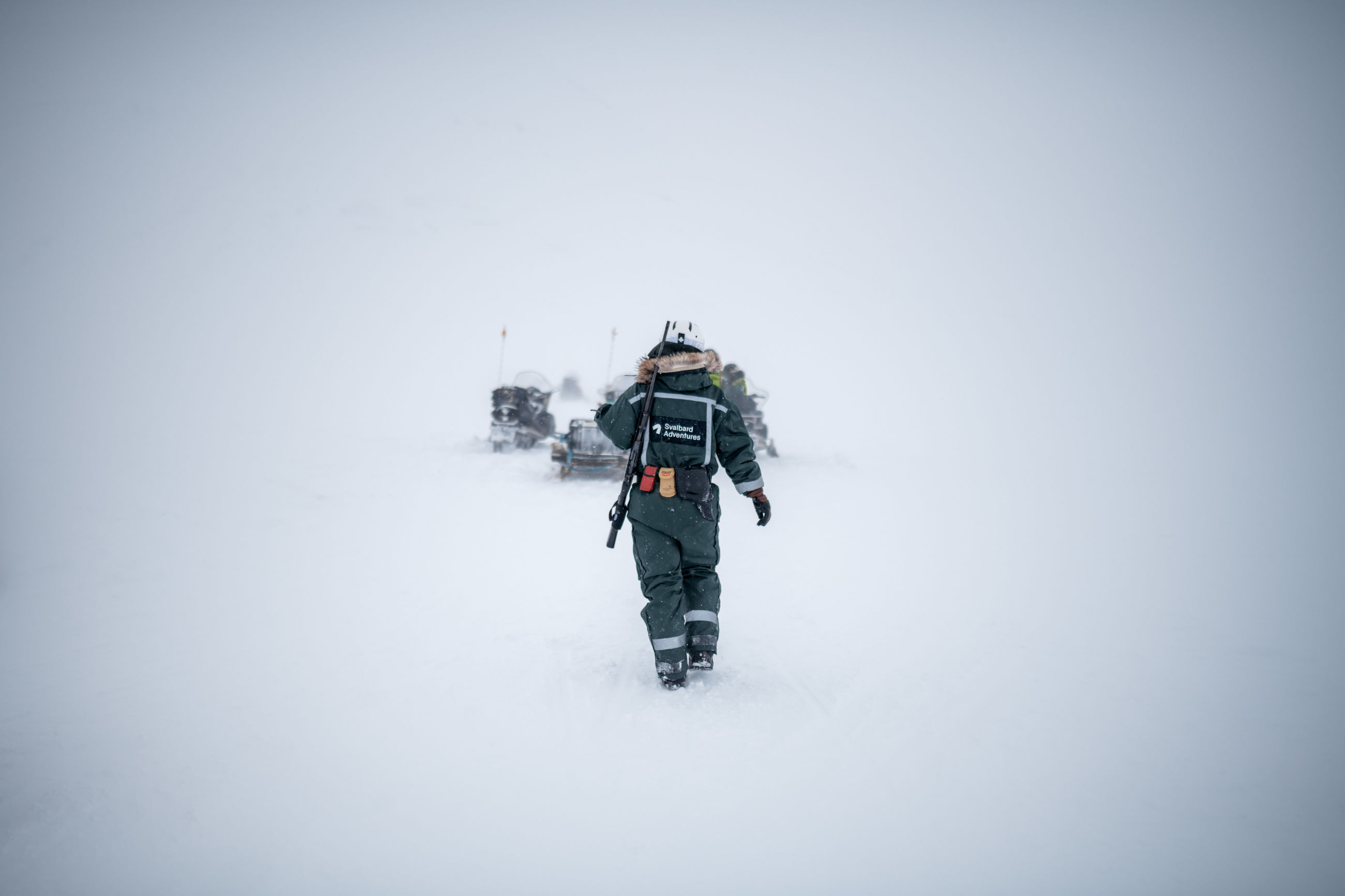 winter, snow, cold temperature, one person, leisure activity, warm clothing, hiking, clothing, copy space, walking, real people, lifestyles, rear view, adventure, nature, backpack, day, activity, extreme weather