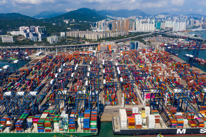 Hong Kong Cargo Terminal Kong Hong Port Container Ship Export Shipping  Industrial Trade Commercial Transportation Harbor Business Truck Commerce Dock Freight Sea Industry Goods Maritime Transport Delivery Crane Loading China Busy Yard Import Kwai Chung Kwai Chung City Top View Aerial Fly Drone  Over Above Down Top Down Panoramic Hk HongKong