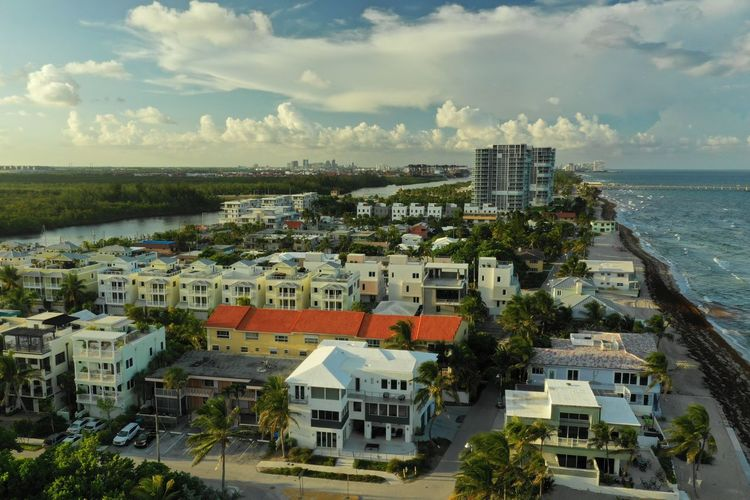Living by the Sea Aerial Shot Dji Mavic 2 Pro Architecture Building Building Exterior Built Structure City Cityscape Cloud - Sky Day Florida High Angle View Horizon Nature No People Outdoors Plant Residential District Sea Sky Tree Water