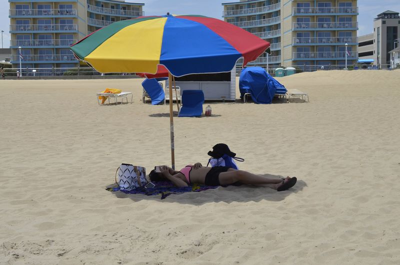 Beach Beach Life Beach Umbrella Blue Casual Clothing City City Life Colourful Day Full Length Leisure Activity Lifestyles Lying Down Outdoors Relaxation Relaxing Resting Sand Sitting Sunny Day Tourist Umbrella Vacations Virginia Beach Woman Miles Away Mobile Conversations Women Around The World Live For The Story Place Of Heart Breathing Space Done That. Connected By Travel
