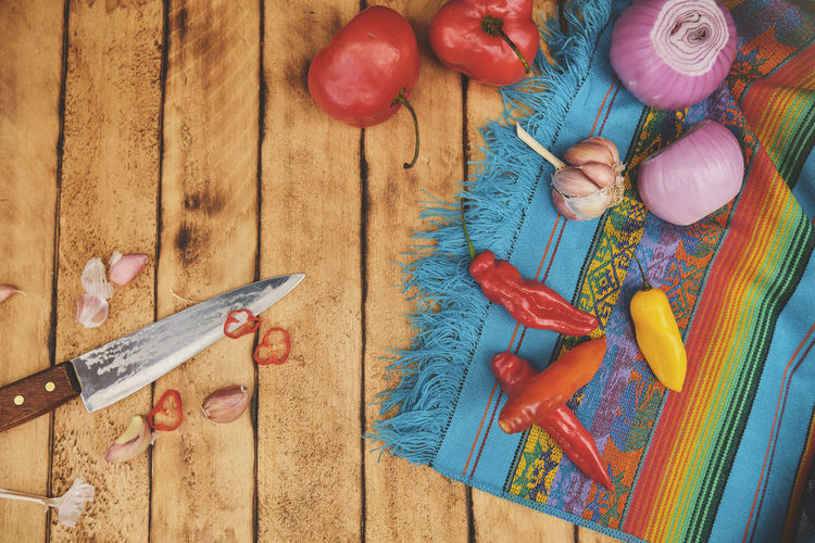 High angle view of various vegetables on cutting board