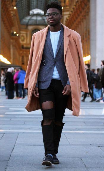 Full length of a woman walking on sidewalk