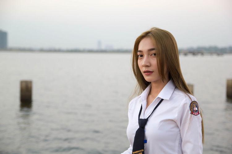 Portrait of sailor against sea