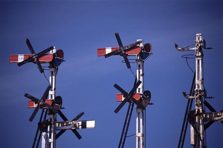 3 old style mechanical railway signals 2 Aspect 4 Aspect Array Australia Blue Sky Gantry Old Railway Railways Signal Rusted Signals Tower Train