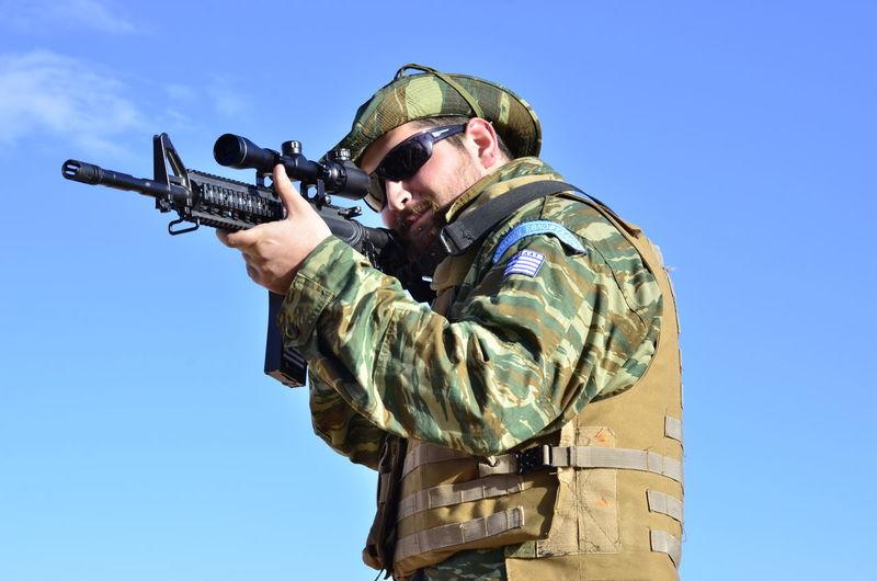 Full Length Of Man Aiming Gun