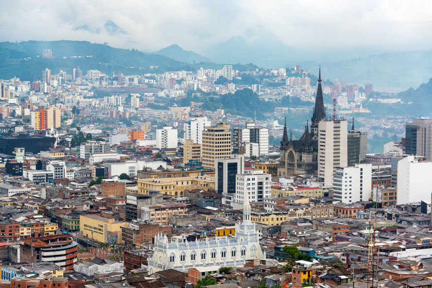 View of downtown Manizales, Colombia with the cathedral visible Architecture Cathedral Church Cityscape Cloudy Colombia Downtown Green Manizales Skyline Travel Building Exterior Built Structure Caldas Churches Cloud - Sky Coffee Triangle Eje Cafetero Overcast Sky South America Tourism Travel Destinations Urban