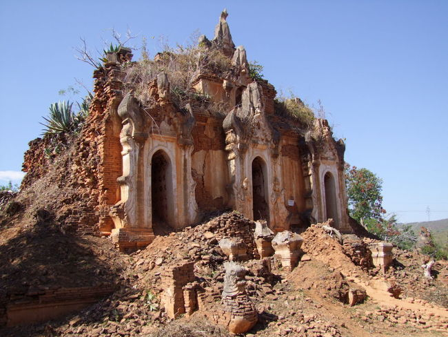 Buddhist Temple Ruins (11th to 13th century) Ancient Ruins Blue Sky Buddhism Buddhist Architecture Buddhist Pagoda Buddhist Temple Composition Earthquake Effects Full Frame Inle Lake Kakku Myanmar No People Outdoor Photography Overgrowth Place Of Worship Religion Religion And Beliefs Rubble Shan State Sunlight And Shadow Temple Ruins Tourist Attraction  Tourist Destination Tree