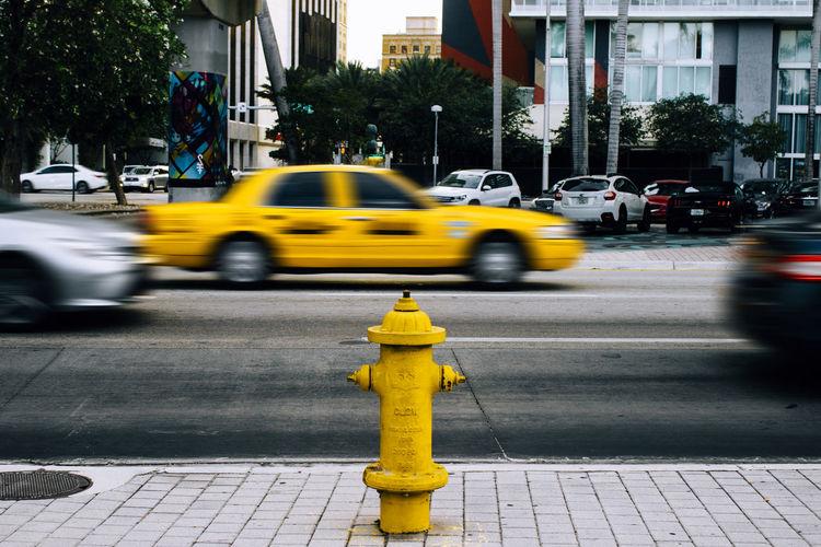 Yellow car on city street