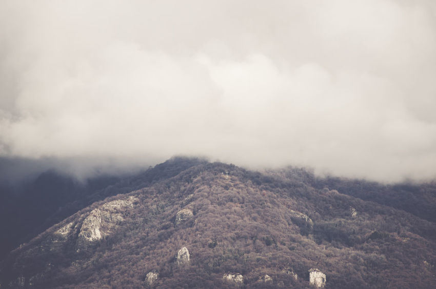 cloudy sky over foothills Beauty In Nature Cloud - Sky Day Fog Landscape Mountain Nature No People Outdoors Scenics Sky
