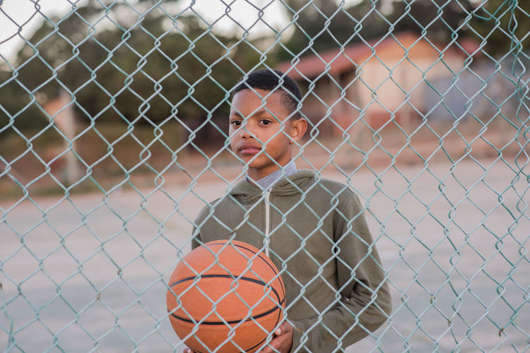 baller Ball Basketball - Ball Boys Child Childhood Day Fence Focus On Foreground Front View Innocence Leisure Activity Lifestyles Looking Looking At Camera Males  One Person Outdoors Portrait Real People