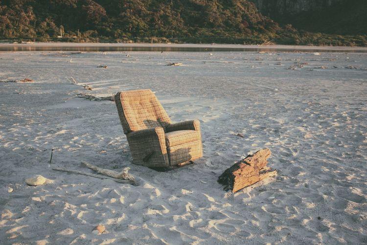 Empty reclining chair on beach