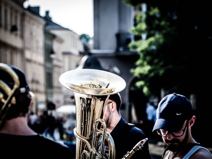 Trumpet Music Celebration Arts Culture And Entertainment Focus On Foreground Outdoors Musical Instrument Day Adult Men Building Exterior Only Men Togetherness Musician People Architecture Performance Saxophone Wind Instrument Adults Only