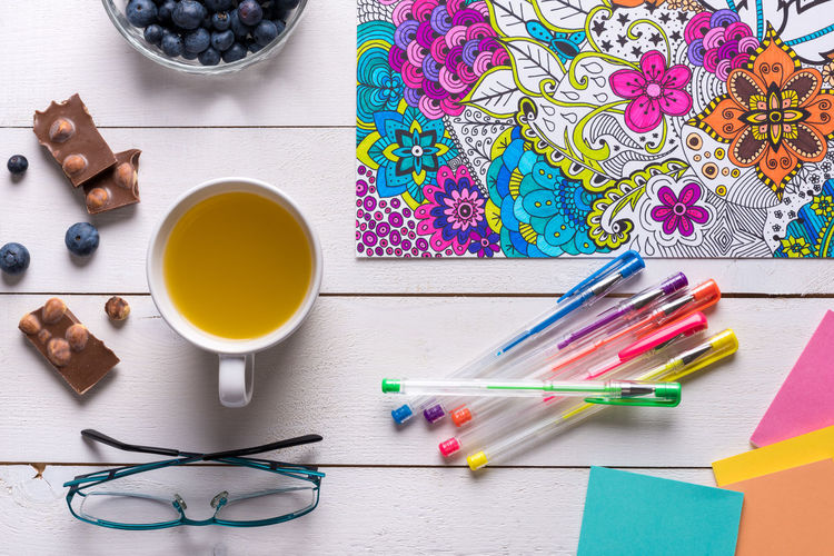 Adult colouring book, new stress relieving trend, flat lay background Adult Art And Craft Books Calming Creativity Relief Stress Therapy Background Book Colouring  Colouring Book Concept Empowering Escape Flat Lay Hobby Lifestyles Mindfulness Pen Relax Relaxation Self Care  Top View Unplugged