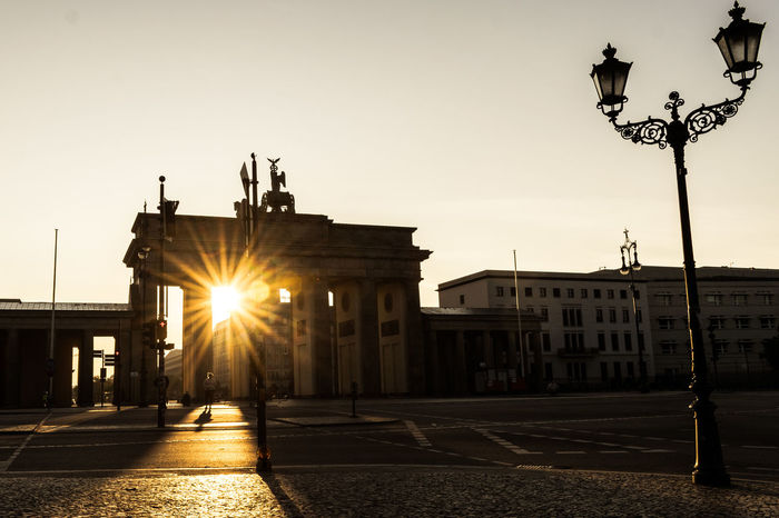 [The Darkside of the Tor] . . . . . #sunset #berlinmitte #brandenburgertor #shadow #agameoftones #iloveberlin #nophotoshop #berlinerpost #diewocheaufinstagram #ig_urbex #sun #photography #pictoftheday #shoot2kill #sonnenaufgang #ditisberlin #officialfanofberlin #exploreberlin #topberlinphoto #visit_berlin #ig_europe #ig_berlin #ig_deutschland #ig_france #ig_italy #diestadtberlin #berlin #unlimitedberlin #urbanexplorer #urbanvisionaries Berlin Berlin Mitte Architectural Column Architecture Branderburgertor Building Exterior Built Structure City City Gate Clear Sky Lens Flare Light Beam Lighting Equipment Nophotoshop Sculpture Silhouette Sky Statue Street Light Sun Sunbeam Sunlight Sunrise Sunset Travel Destinations The Week On EyeEm