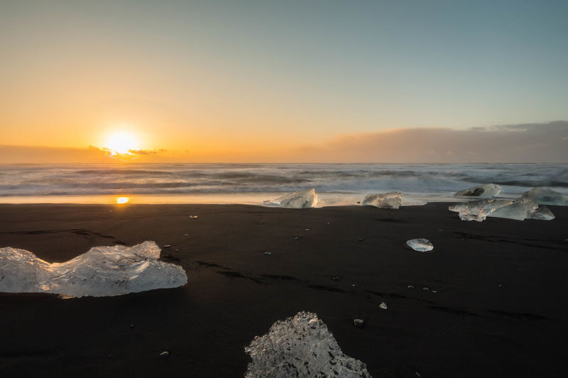 Beach Beauty In Nature Black Sand Beach Iceland Day Horizon Over Water Nature No People Orange Color Outdoors Salt - Mineral Sand Scenics Sea Sky Sun Sunlight Sunlight Reflection Sunset Tranquil Scene Tranquility Water Wave